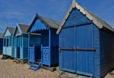 Cuatro chozas de la playa Imagenes de archivo