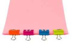 Cuatro clips en el papel de la oficina Imagen de archivo libre de regalías
