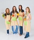 Cuatro cocineros de sexo femenino Imagen de archivo