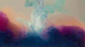 Cuatro colores de la tinta caídos en agua Foto de archivo libre de regalías