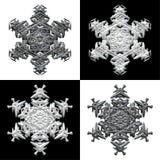Cuatro copos de nieve en backround blanco y negro Imágenes de archivo libres de regalías