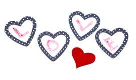 Cuatro corazones con amor de la palabra Imagen de archivo