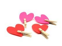 Cuatro corazones con los contactos de madera Imagen de archivo