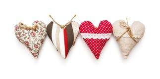 Cuatro corazones de la tarjeta del día de San Valentín en el fondo blanco Fotografía de archivo libre de regalías