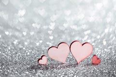 Cuatro corazones en brillos Imágenes de archivo libres de regalías