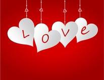 Cuatro corazones en un fondo de la pendiente Corte el papel Tarjeta de felicitación Foto de archivo libre de regalías