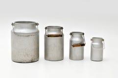 Cuatro crisoles de la leche Fotografía de archivo libre de regalías