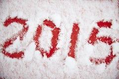 Cuatro dígitos escritos en la nieve blanca Fotografía de archivo