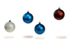 Cuatro decoraciones de la bola de la Navidad Imágenes de archivo libres de regalías