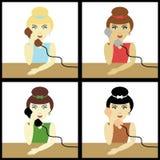 Cuatro diversas muchachas con los teléfonos Foto de archivo libre de regalías