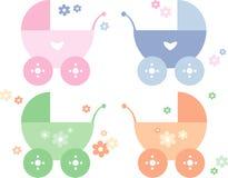 Cuatro diversos cochecitos de niño coloreados del bebé Imágenes de archivo libres de regalías