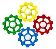 Cuatro engranajes coloridos en la sincronización Foto de archivo libre de regalías