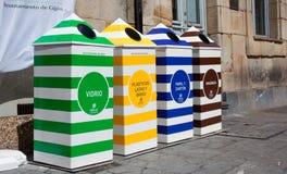Cuatro envases para reciclar Imágenes de archivo libres de regalías