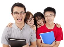 Cuatro estudiantes felices que se unen Imagen de archivo
