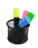 Cuatro etiquetas de plástico coloreadas en organizador del escritorio Fotografía de archivo