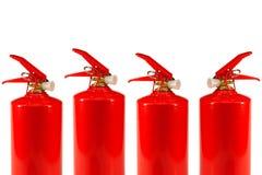 Cuatro extintores Imagen de archivo