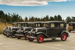 Cuatro 1930 A Fords modelo en el parque de estado de la playa de Hammonasset, CT Fotos de archivo libres de regalías