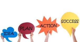 Cuatro globos de discurso con éxito de la acción del plan de la idea Fotografía de archivo libre de regalías