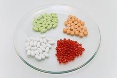 Cuatro grupos de alimento en píldoras Imagen de archivo libre de regalías
