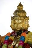 Cuatro hicieron frente a la estatua china del templo Fotos de archivo libres de regalías