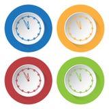 Cuatro iconos redondos del color, reloj de última hora Foto de archivo