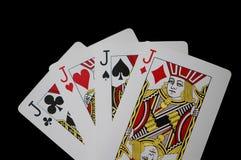 Cuatro jugaron a tarjetas del enchufe foto de archivo