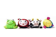 Cuatro juguetes en fila Imagen de archivo