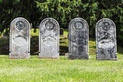 Cuatro lápidas mortuarias antiguas Imagen de archivo libre de regalías
