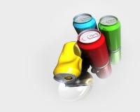 Cuatro latas coloridas de la bebida Foto de archivo libre de regalías