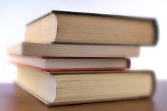 Cuatro libros - el foco seleccionó Fotos de archivo libres de regalías