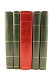 Cuatro libros verdes y un rojos aislados Imágenes de archivo libres de regalías