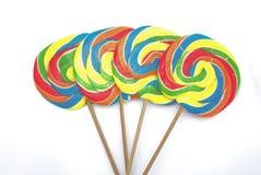 Cuatro lollipops en el fondo blanco Foto de archivo libre de regalías
