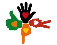 Cuatro manos multicoloras Fotografía de archivo