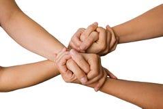 Cuatro manos que se detienen Fotografía de archivo libre de regalías