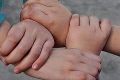 cuatro manos unidas Fotos de archivo libres de regalías