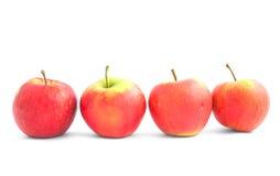 Cuatro manzanas en la línea Imagen de archivo libre de regalías
