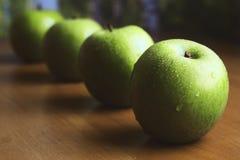 Cuatro manzanas verdes grandes Foto de archivo libre de regalías