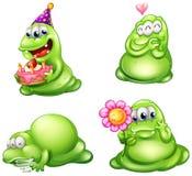 Cuatro monstruos verdes con diversas actividades Imágenes de archivo libres de regalías