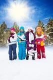 Cuatro muchachas con los patines de hielo Foto de archivo