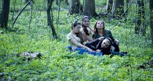 Cuatro muchachas en bosque Imagen de archivo libre de regalías