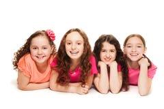 Cuatro amigos de muchachas felices Imágenes de archivo libres de regalías