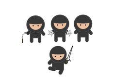 Cuatro ninja que luchan en equipos negros Imagen de archivo libre de regalías