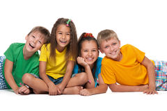 Cuatro niños de risa Imágenes de archivo libres de regalías