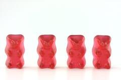 Cuatro osos gomosos rojos Foto de archivo