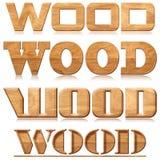 Cuatro palabras de madera en la talla de madera Imagen de archivo