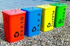 Cuatro papeleras de reciclaje coloridas Imágenes de archivo libres de regalías