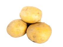 Cuatro patatas Imagen de archivo libre de regalías