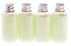 Botellas verdes aisladas de la loción Foto de archivo