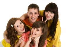 Cuatro personas engañan alrededor en un fondo blanco Imagen de archivo