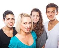 Cuatro personas jovenes hermosas Foto de archivo libre de regalías